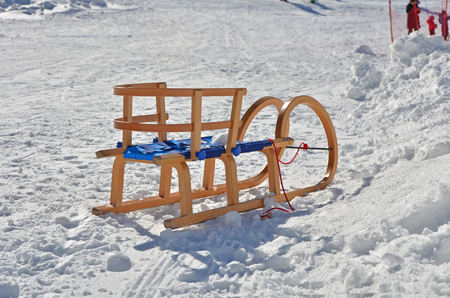 antique sleigh: wooden sleds on snow