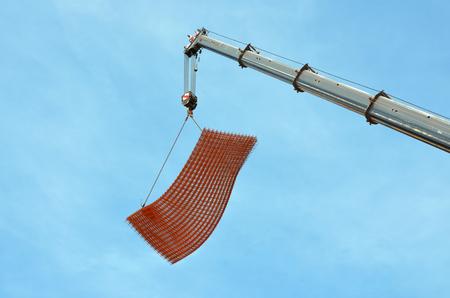 armature: crane lifts armature on the construction site Stock Photo
