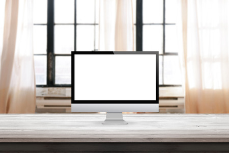 computer display on desk et home office interior with windows in the background mock up presentation