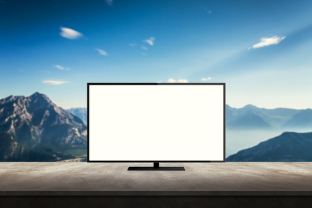 isolated tv on desk with mountain nature background for mock up presentation Stock Photo