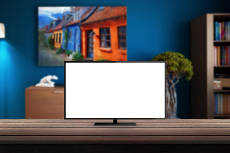 lcd tv: isolated tv on wooden desk in room background for mock up presentation