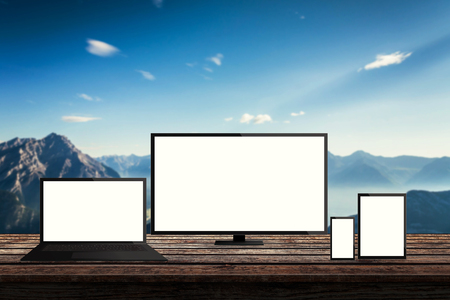 responsive: isolated responsive computer and mobile devices on desk with mountain nature background for mock up presentation
