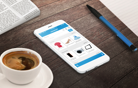 on line shopping with smart phone on wooden table relax time with coffee newspaper pencil growing marketing concept Imagens