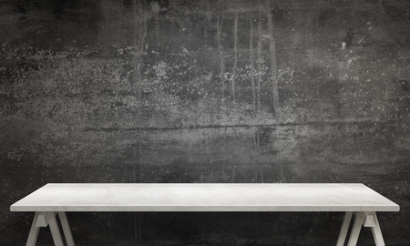 textured wall: Modern white table with legs and free space. Black wall texture in background.