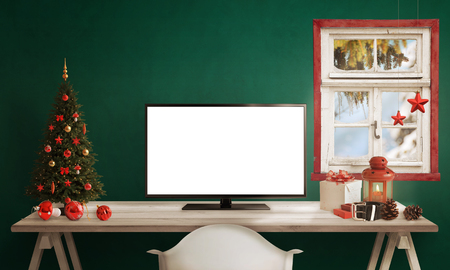 computer isolated: Computer display on table with isolated white screen for mockup in Christmas time. Christmas tree, gifts, decorations in background. Stock Photo