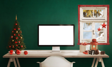 christmas lights display: Computer display on table with isolated white screen for mockup in Christmas time. Christmas tree, gifts, decorations in background. Stock Photo
