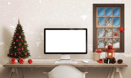 Computer display on table with isolated white screen for mockup in Christmas time. Christmas tree, gifts, decorations in background. Imagens