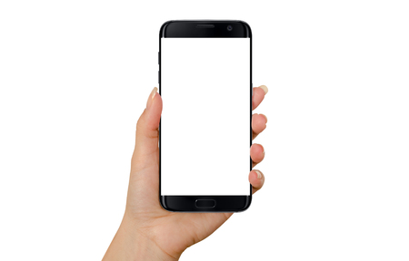 horizontal position: Modern black smart phone in woman hand in horizontal position. White screen for mockup, isolated. Stock Photo