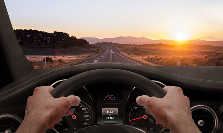 wonderfull: Driving at sunset. View from the driver angle while hands on the wheel.