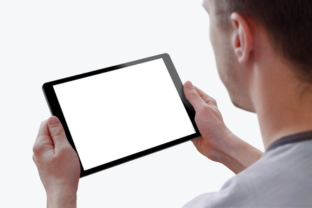blank tablet: Tablet with isolated screen for mockup in man hands. Isolated white background. Isolated device screen for design, interface promotion.