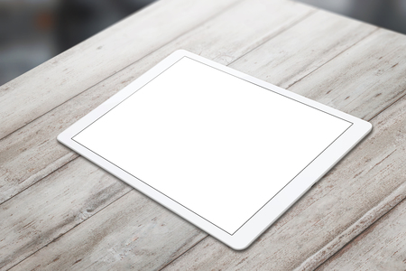 horizontal position: White tablet on wooden table with isolated white screen for mockup. Horizontal position isometric view.