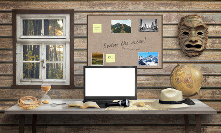 adventurer: Adventurer office desk with laptop. Isolated, white screen for mockup. Mask, globe, rope, hourglass, hat, book on desk and wooden wall