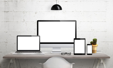 Responsive devices on desk with isolated screen for mockup. Computer display, laptop, tablet and smart phone. 版權商用圖片 - 56239009