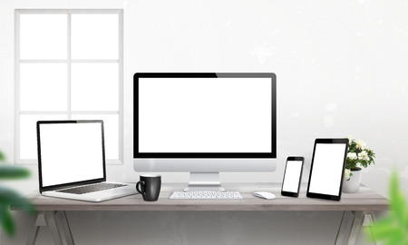 Responsive devices on desk with isolated screen for mockup. Computer display, laptop, tablet and smart phone. 版權商用圖片 - 56239012