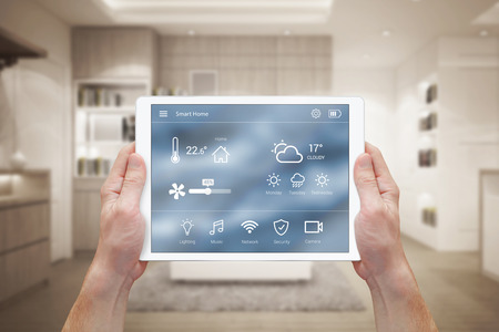 Smart home control on tablet. Interior of living room in the background. Stockfoto