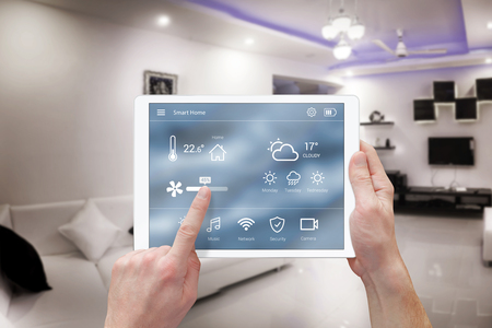 smart home: Smart remote home control system app. Living room interior in background.