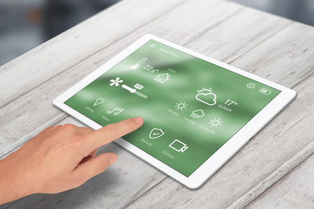 Man use smart home control on tablet.