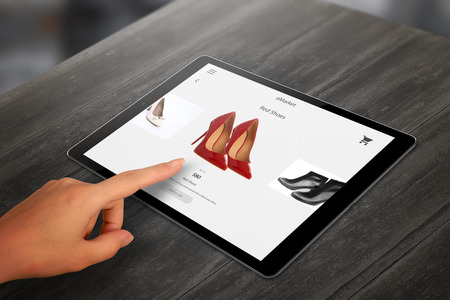 Shopping with tablet. Woman buy red shoes on online market. 版權商用圖片 - 58891229