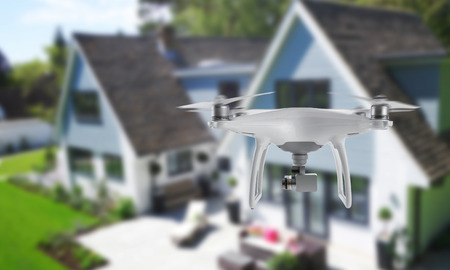 Drone quad copter with camera spying on the house and yard. 스톡 콘텐츠