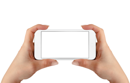 horizontal position: Smart phone in woman hands. Horizontal position. Isolated screen for mockup. Stock Photo