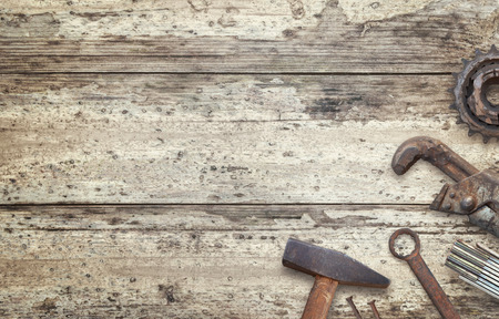 Old tools on wooden table with free space for text. Traditional handmade tools for craftsmen.