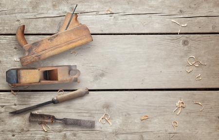 wood planer: Wood planer and chisel on wooden desk.