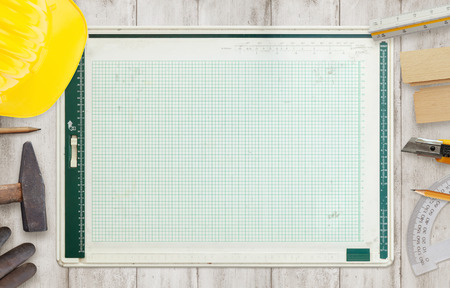 architect tools: Architect drawing board surrounded by construction tools.