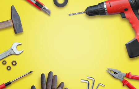 home repairs: Tools for home repairs. Hammer, drill, wrench, scalpel, gloves, tape, screws, pliers, screwdriver. Top view and free space for text.
