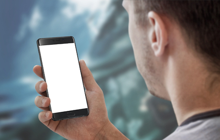 Man holding and work on modern smart phone with white isolated display for app mockup.