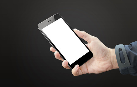 Black smart phone in man hand. Blank screen of mobile device for mockup. Dark black background.