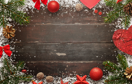 Wooden table with christmas decorations. Top view of board with free space for greeting text.