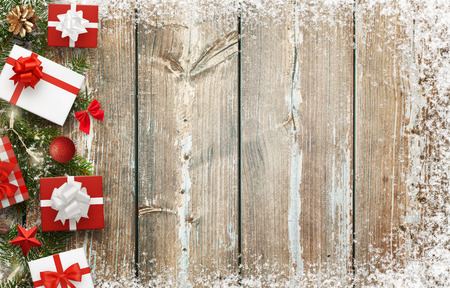 Christmas background image with gifts and christmas tree decoration with free space for text. Top view.