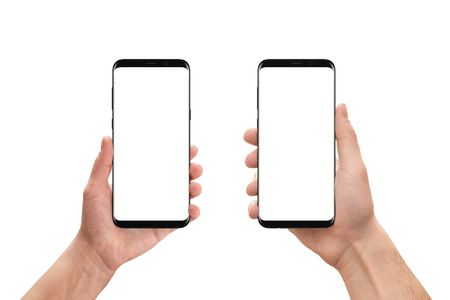 woman on phone: Isolated mobile phones in woman and man hand. Isolated white, blank screen for mockup, app presentation. White background. Stock Photo