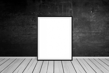 leaned: Picture frame leaned on black wall. Empty, white space for mockup art presentation. Wooden floor. Empty room. Stock Photo
