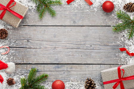 Christmas Xmas background with copy space for text. Christmas fir branches, giftse, lollipop, Santa hat, pinecones and snowflakes on wooden table. Top view. Stockfoto