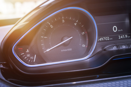 Car tachometer close up. Modern interior with blue led light.