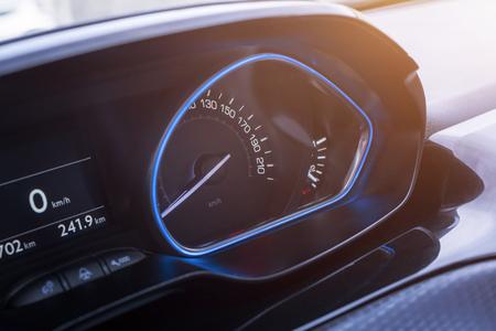 Car speedometer close up. Modern blue interior design.