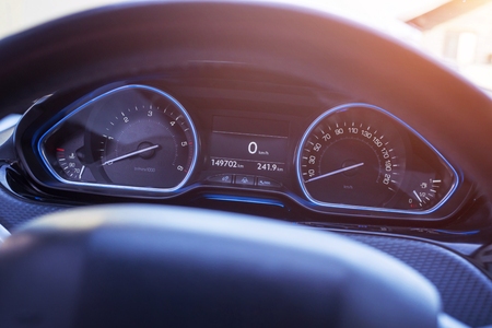 Car speedometer with blue led light. Modern car interior. Stock Photo