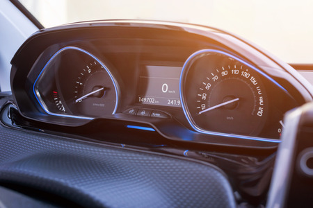 Car speedometer close up. Modern car interior with blue led light. Stock Photo