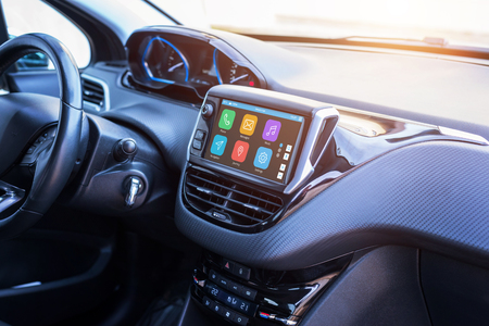 Modern car infotainment system with phone, messages, music, navigation, journey apps. 스톡 콘텐츠
