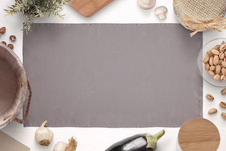 Kitchen table cloth surrounded with ingredients, spices and items for storing food. Old vintage style. Flat lay.