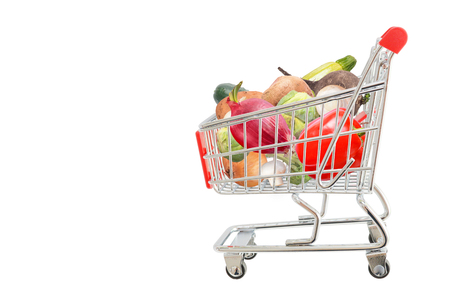 Isolated cart with fresh organic vegetables