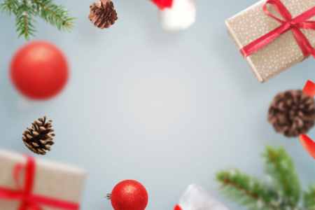 Christmas gifts and decorations levitate above the table. Fre space for text in the middle.