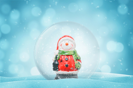 Cute snowman in a glass magic ball. New Year decoration. Copy space beside. Stockfoto