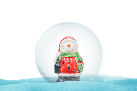 Isolated Christmas crystal magic ball on snow.