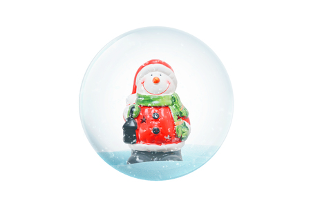 Isolated New Year magic ball with snowman and white snow.