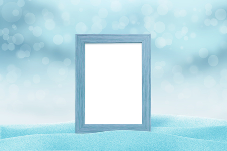 Winter, Christmas, New Year picture frame mockup. Blue light with bokeh in background. Stock Photo