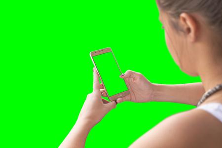 Girl use smart phone. Chroma key isolated.