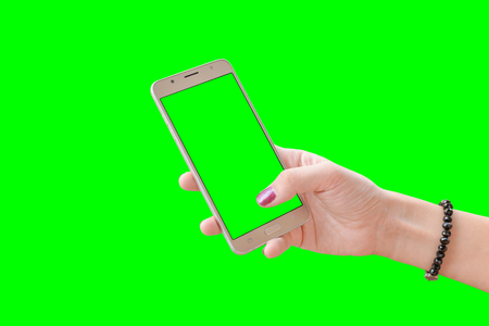 Phone in girl hand, close-up. Isolated in green, chroma key.