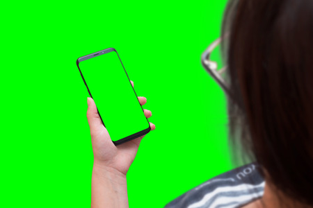 Phone mockup for app presentation. Isolated screen and background in green, chroma key for video editors.